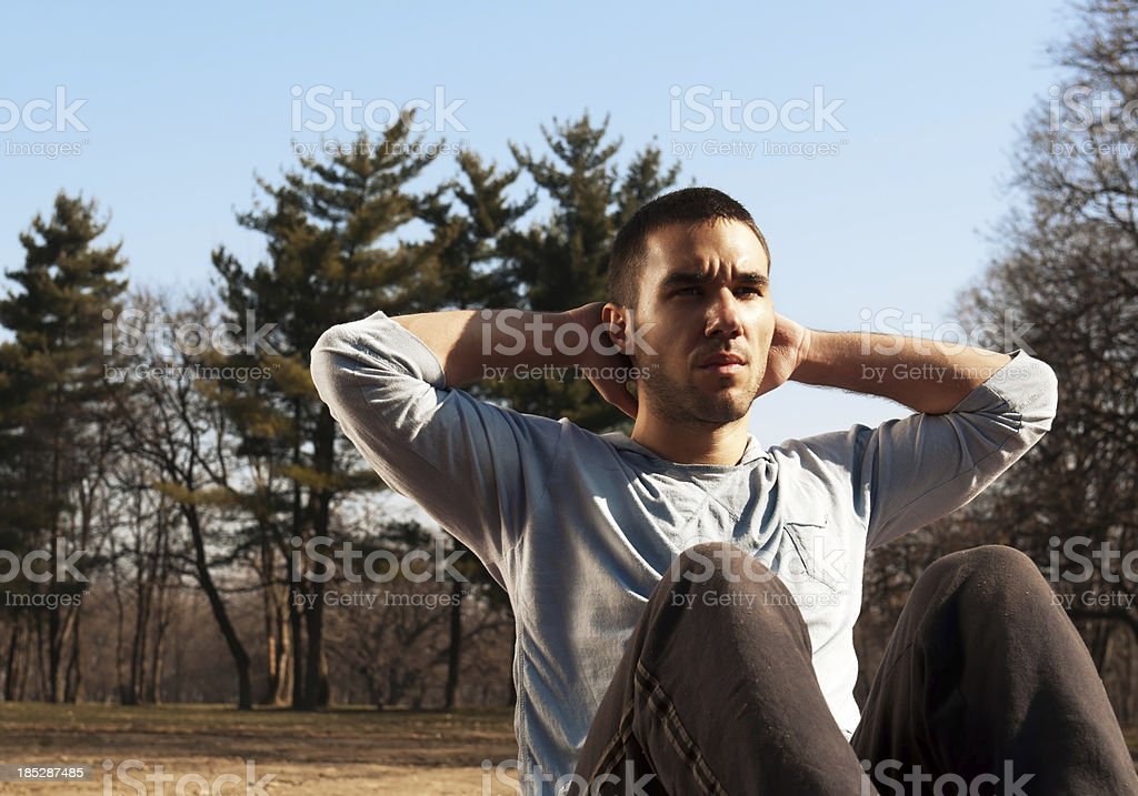 young man exercising outdoors royalty-free stock photo