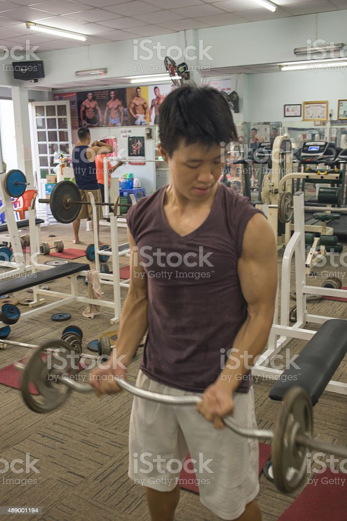 Young man exercising with arm weights stock photo
