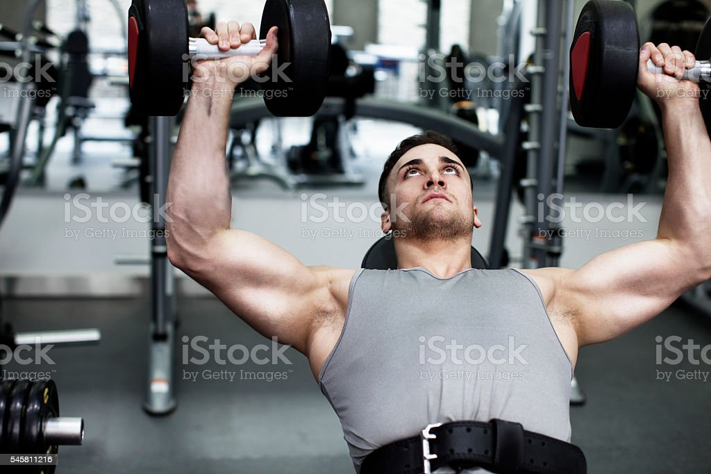 Young Man Exercising with Weights stock photo