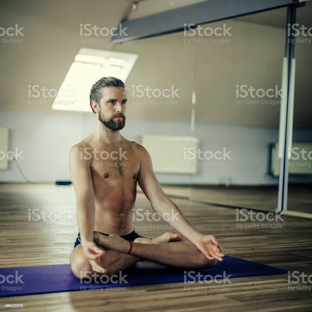 Young man exercising yoga stock photo