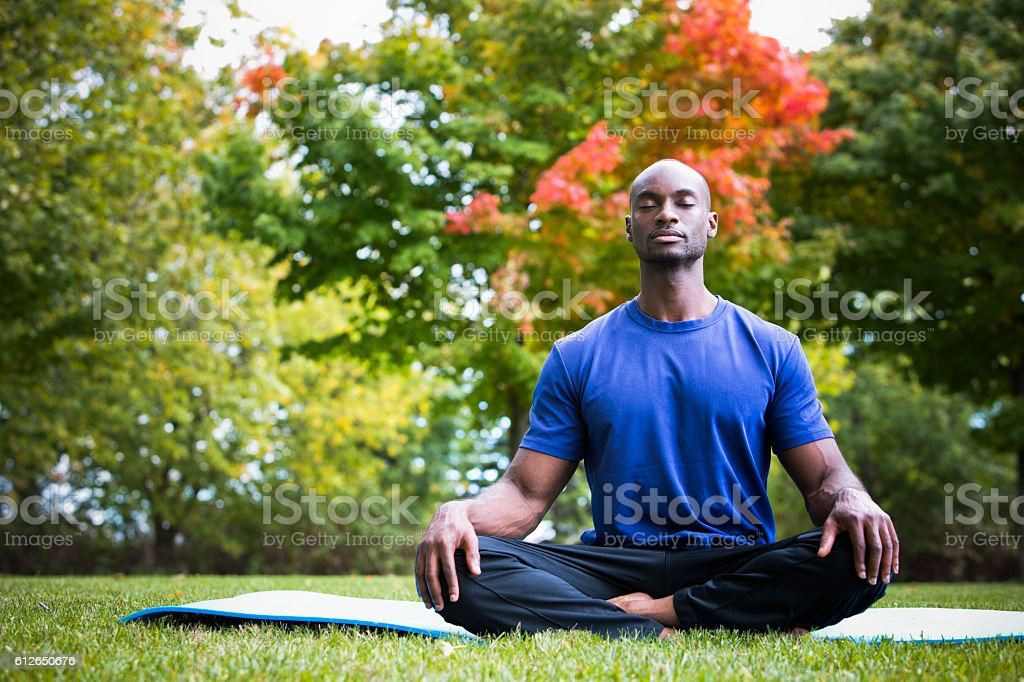 young man exercising yoga stock photo