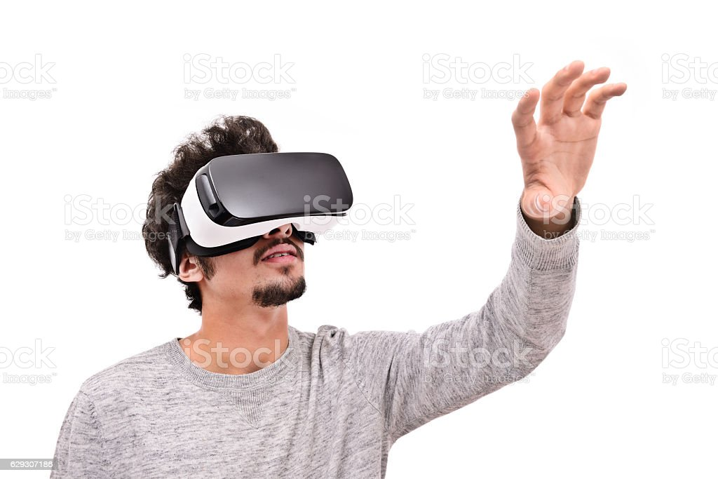 Young man experience with VR headset stock photo