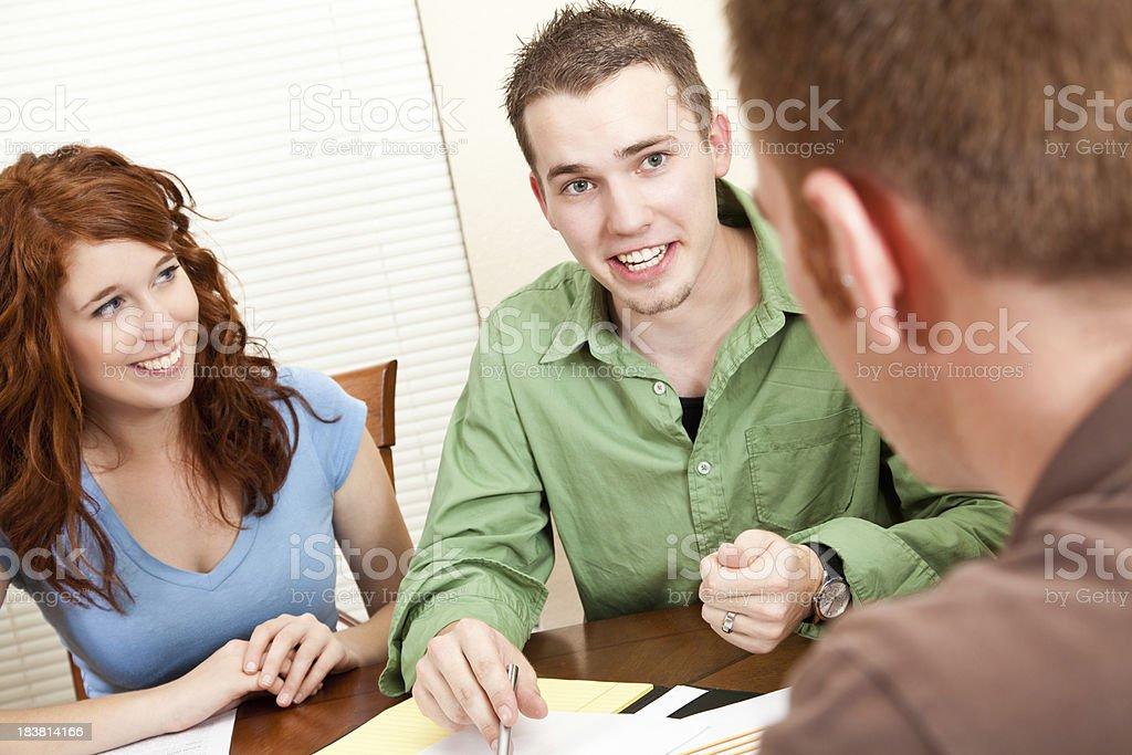 Young man explaining something at table royalty-free stock photo