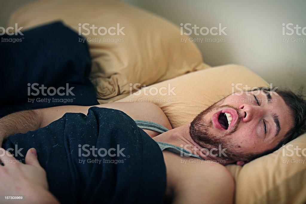 Young Man Fast Asleep in Bed stock photo