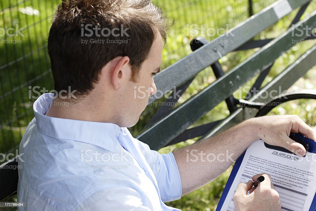Young Man Fills Out Application royalty-free stock photo