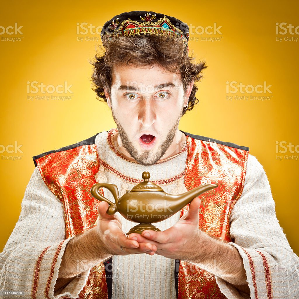 Young man finds alladin''s lamp stock photo