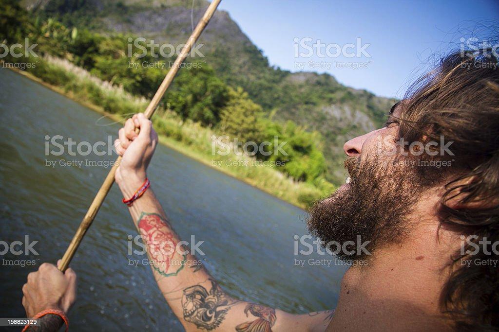 Young man fishing stock photo