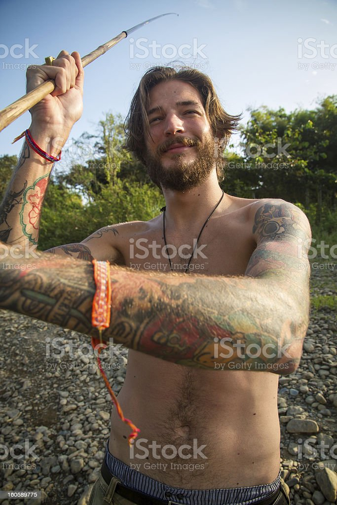 Young man fishing royalty-free stock photo