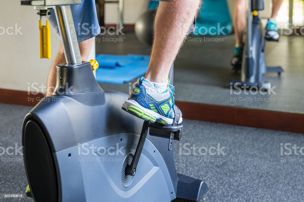 Young man fitness -spinning bicycle stock photo