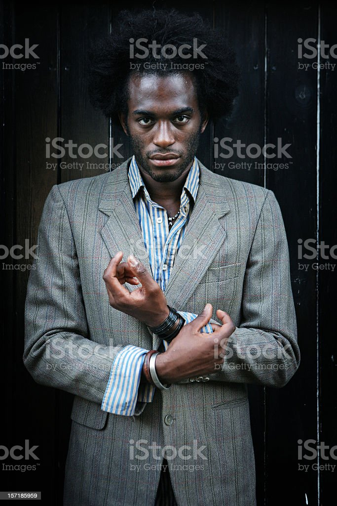 Young Man Fixing his Shirt Cuff royalty-free stock photo