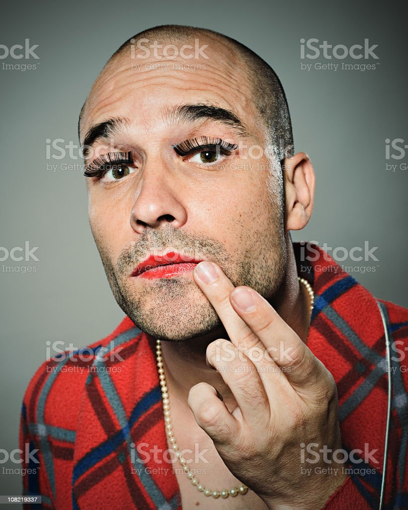 Young man fixing lipstick royalty-free stock photo