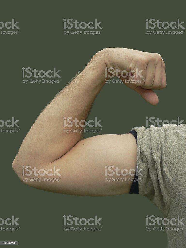Young Man flexing bicep, color stock photo