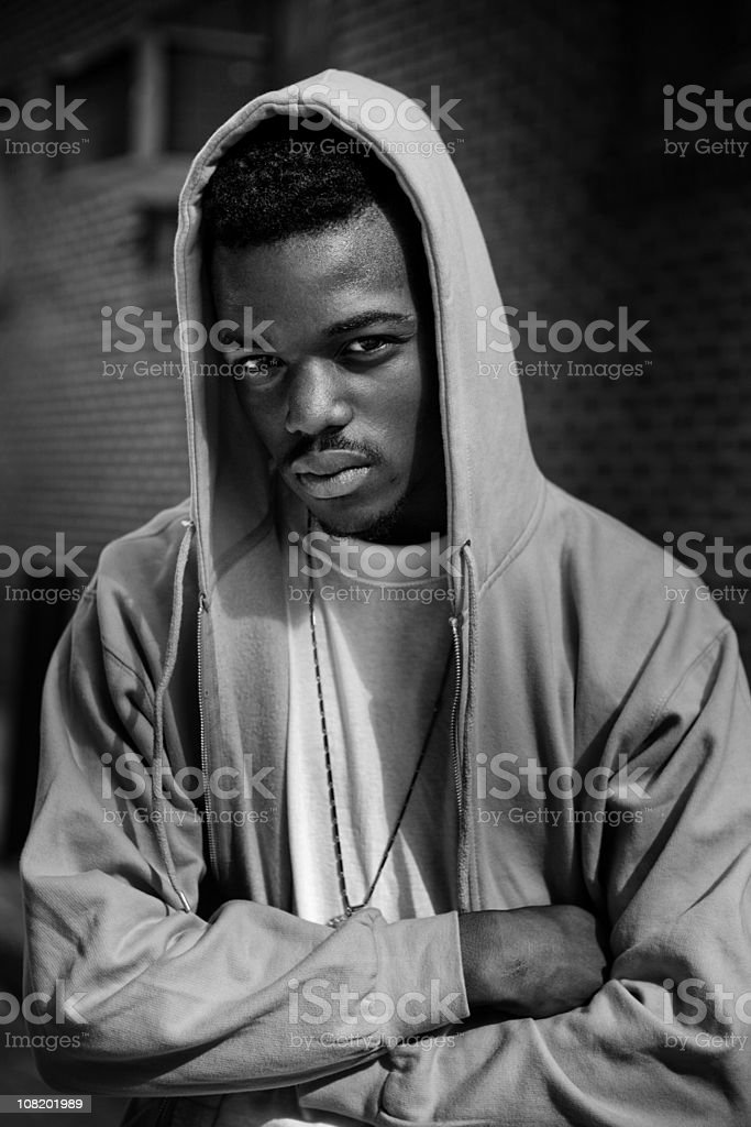 Young Man Folding Arms Wearing Hood, Black and White royalty-free stock photo