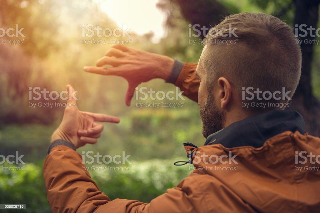Young man framing nature stock photo
