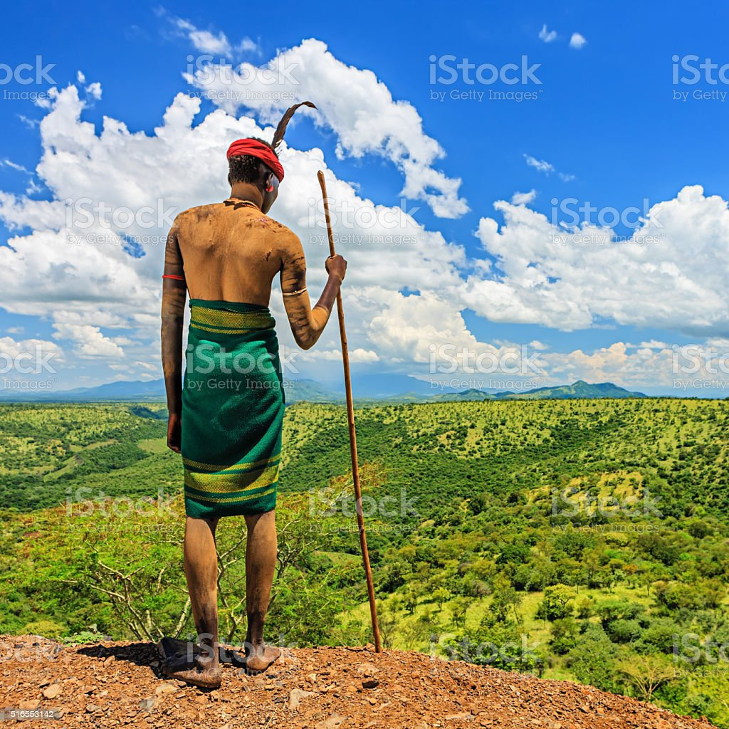 Young man from Mursi tribe looking at view, Ethiopia, Africa stock photo