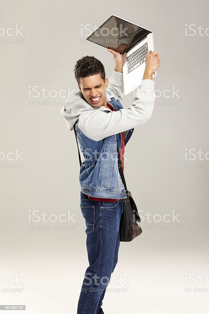 Young man frustrated with laptop stock photo