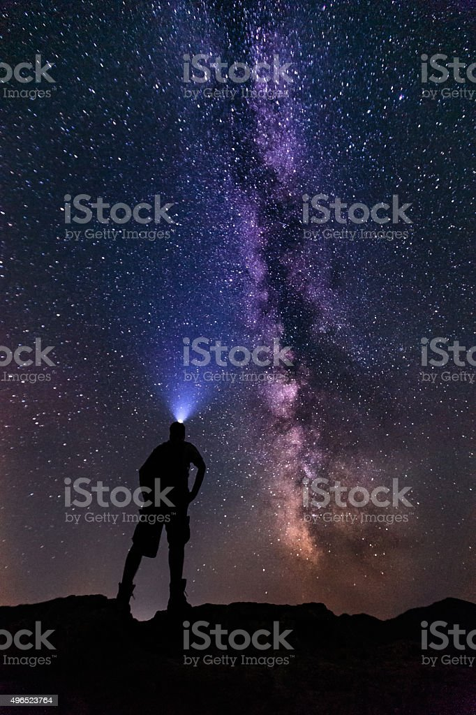 Young man gazing into the starry Milky Way Galaxy-stock image stock photo