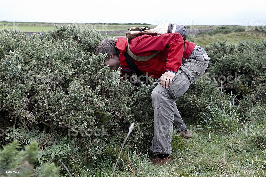 Young man geocaching stock photo