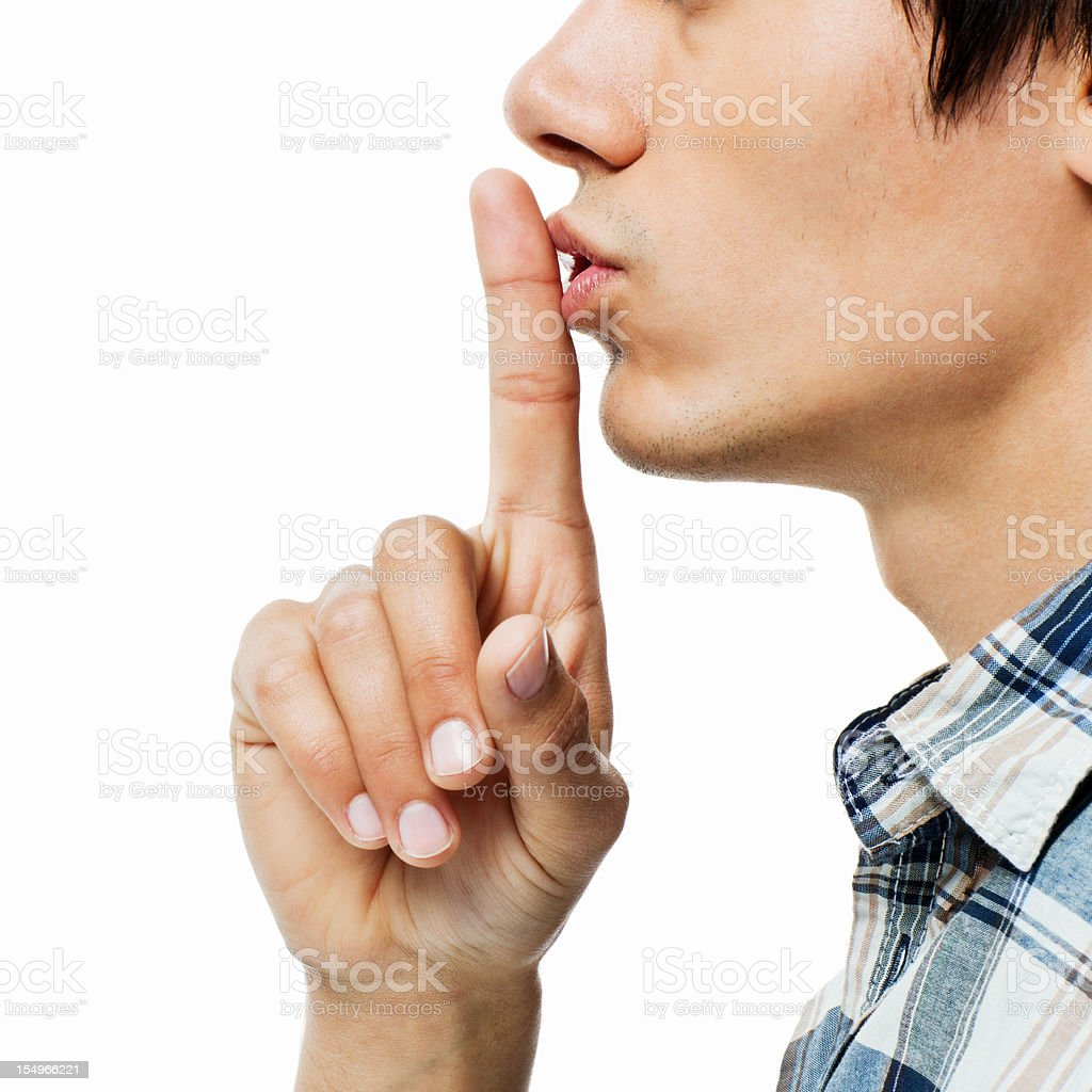 Young Man Gesturing for Quiet stock photo