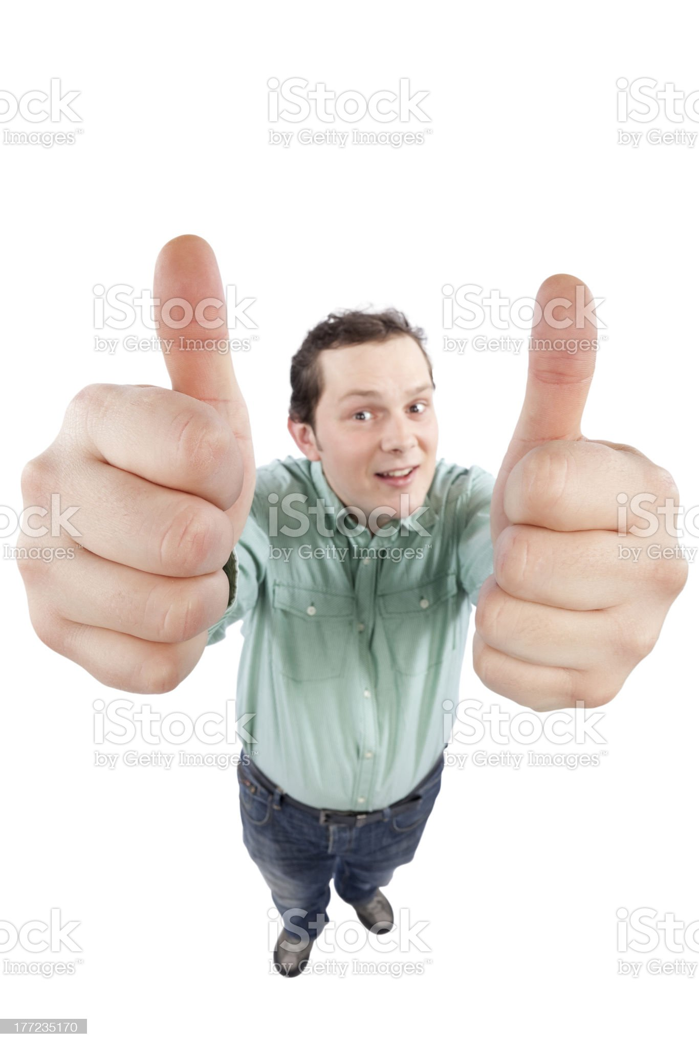 Young man gesturing OK sign with both hands royalty-free stock photo