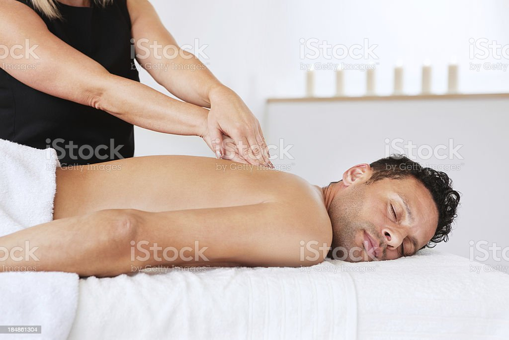 Young Man Getting a Massage royalty-free stock photo