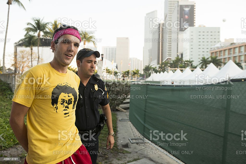 Young Man Getting Arrested by Police Outside Ultra Music Festival stock photo