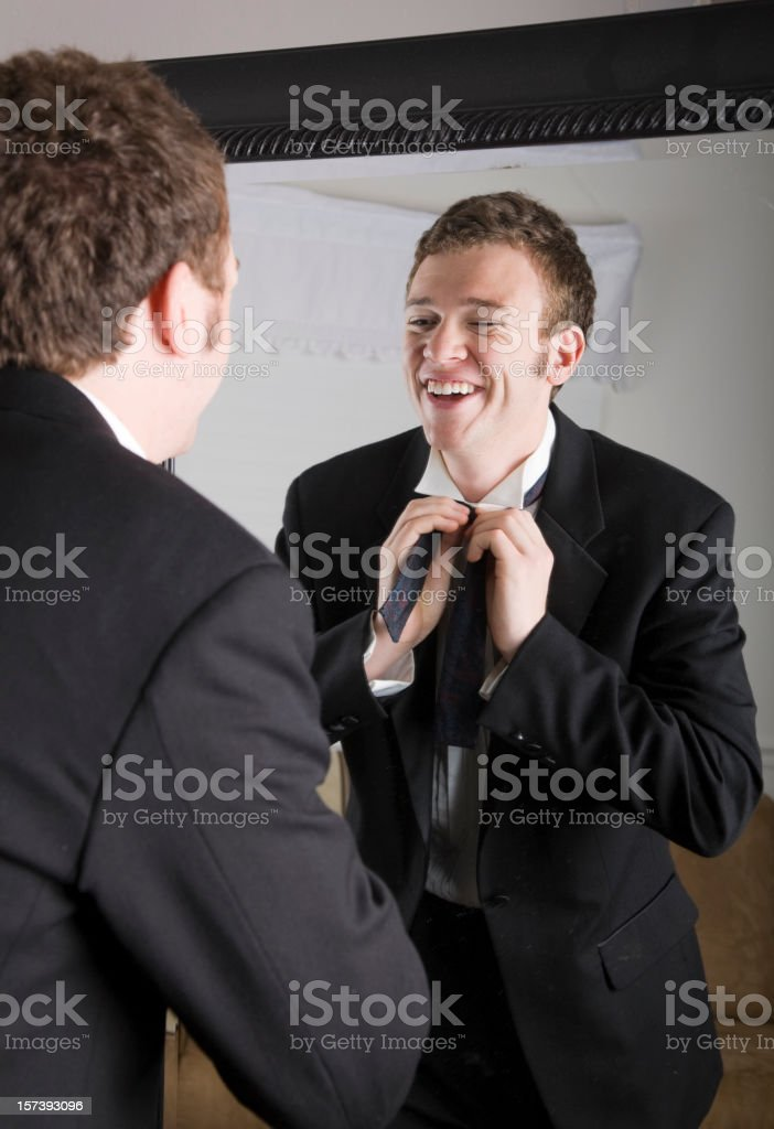 Young Man Getting Dressed royalty-free stock photo