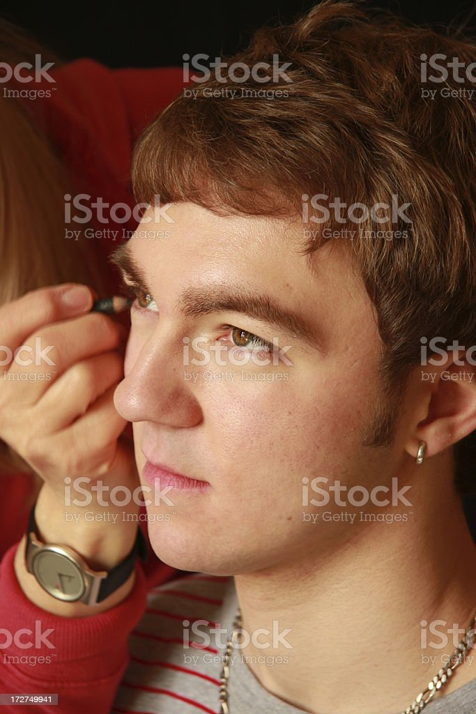 young man getting make-up stock photo