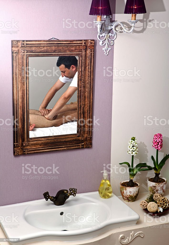 Young man getting massage royalty-free stock photo