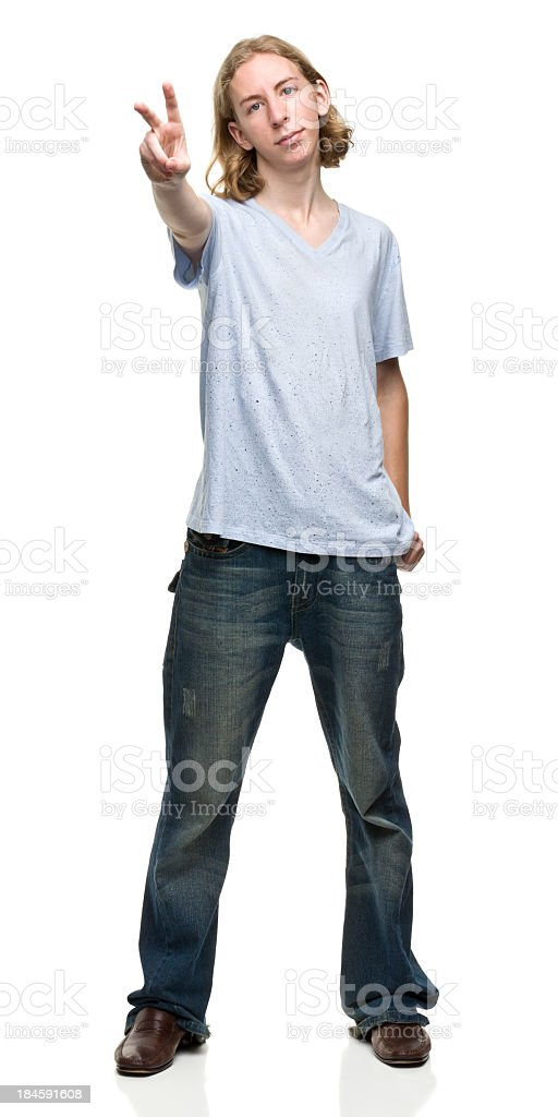 Young Man Gives Peace Sign royalty-free stock photo