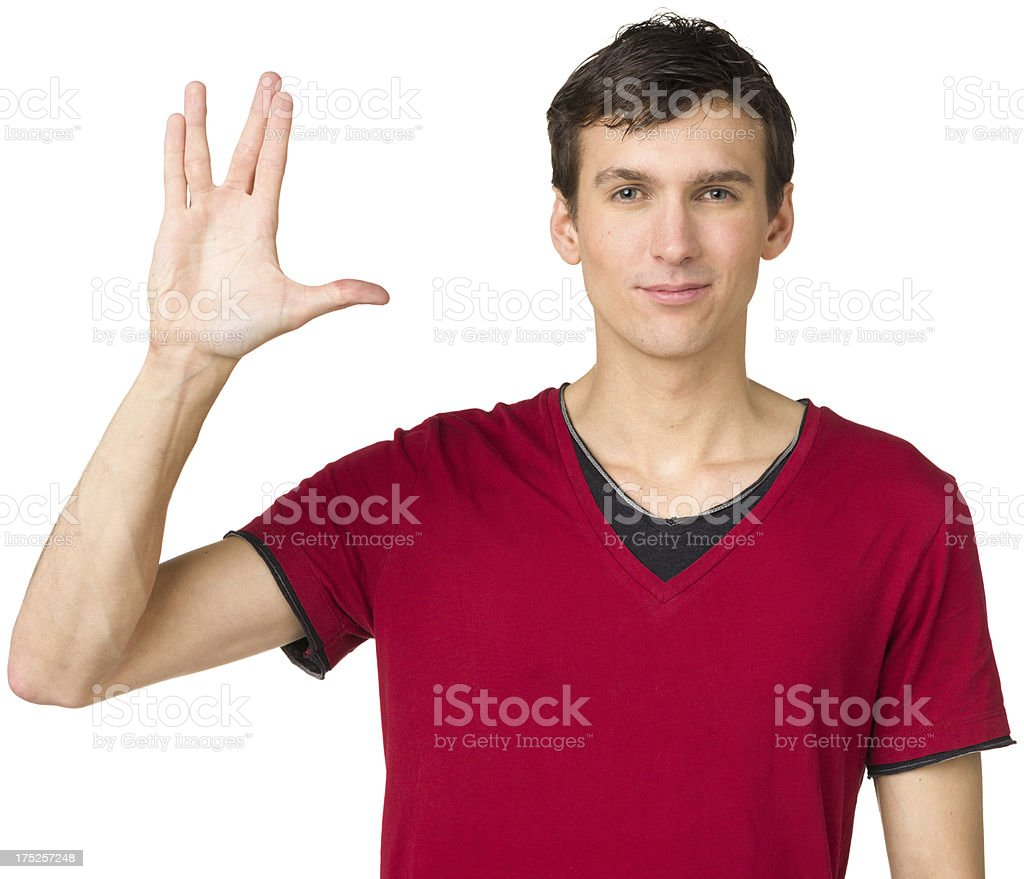 Young Man Gives Vulcan Salute stock photo