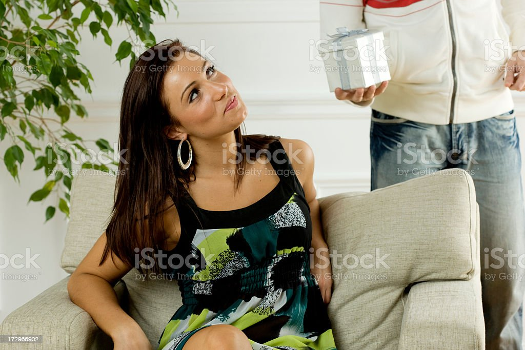 Young man giving girlfriend a gift. stock photo