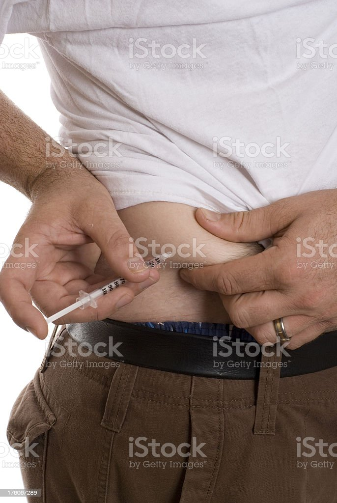 Young Man Giving Himself A Shot stock photo