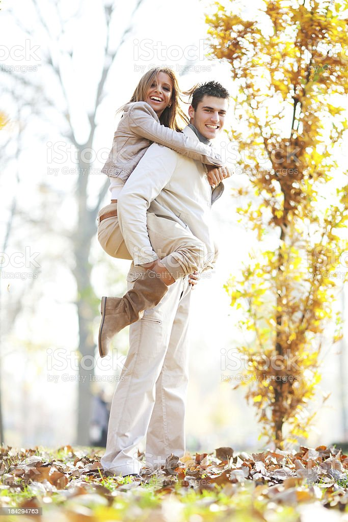 Young man giving his girlfriend a piggyback ride. royalty-free stock photo
