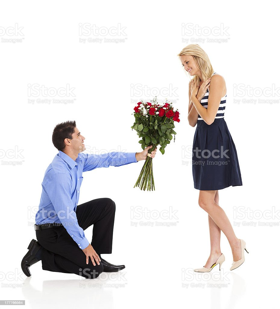 young man giving roses to a woman royalty-free stock photo