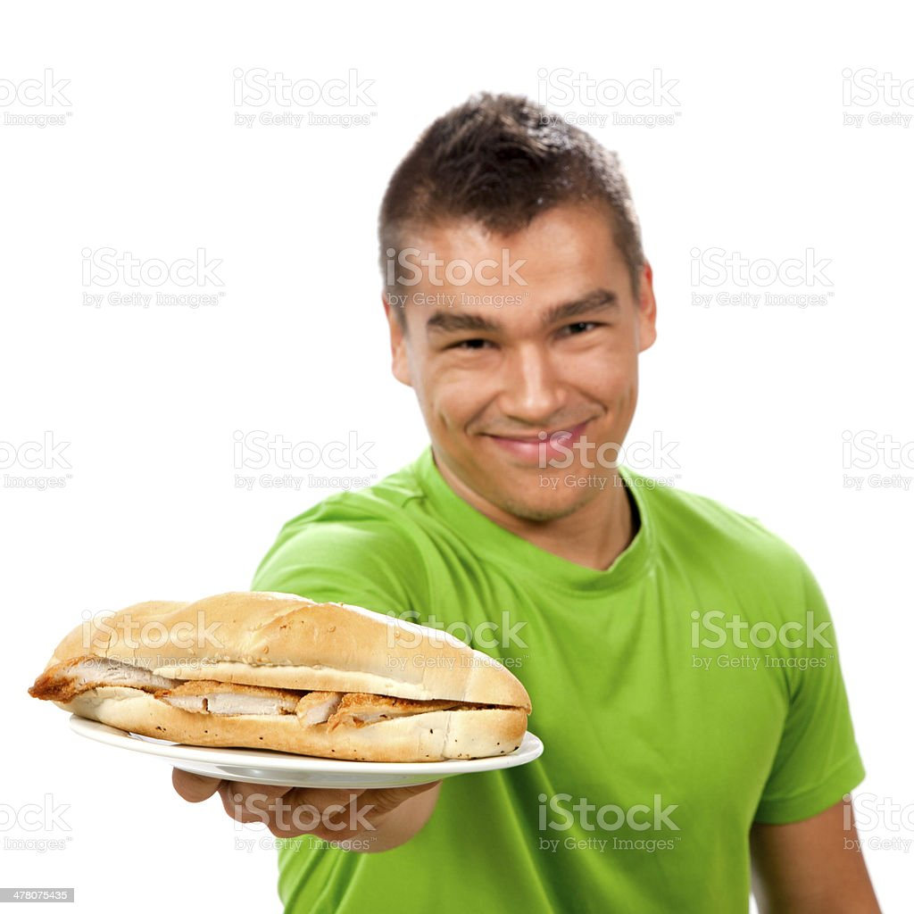 Young man giving sandwich on a plate. royalty-free stock photo