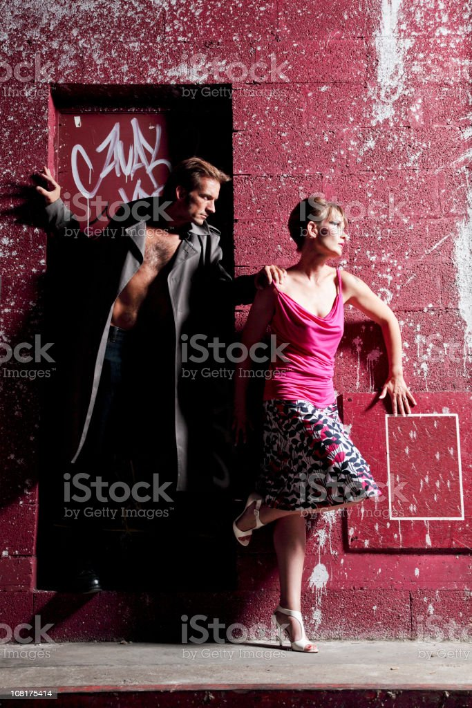 Young Man Grabbing Woman by Shoulder Outside royalty-free stock photo