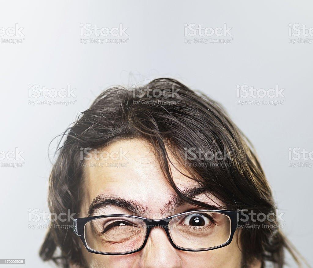 Young man grimacing stock photo