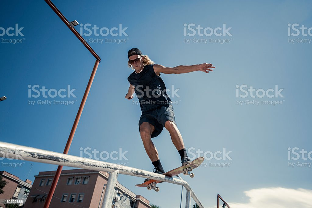 Young man grinding in the city stock photo