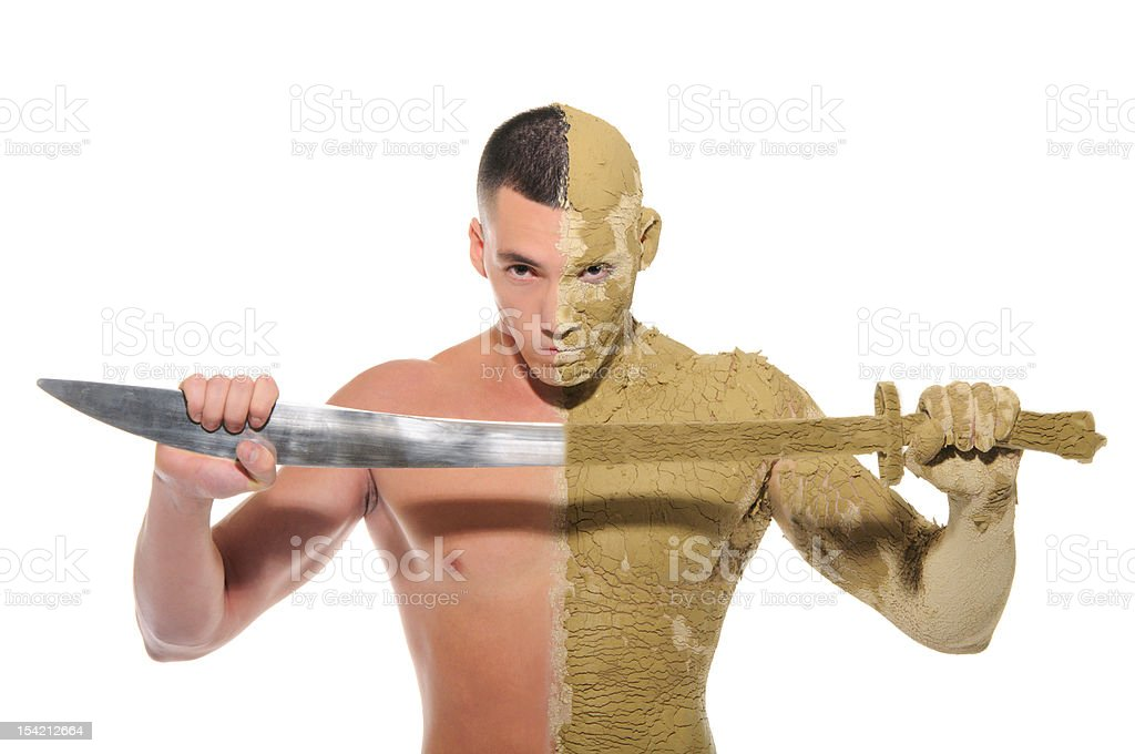 young man half smeared with clay and sword royalty-free stock photo