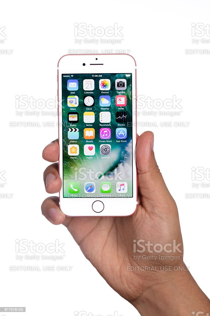 Young man hand holding Apple iPhone 7 Rose Gold stock photo