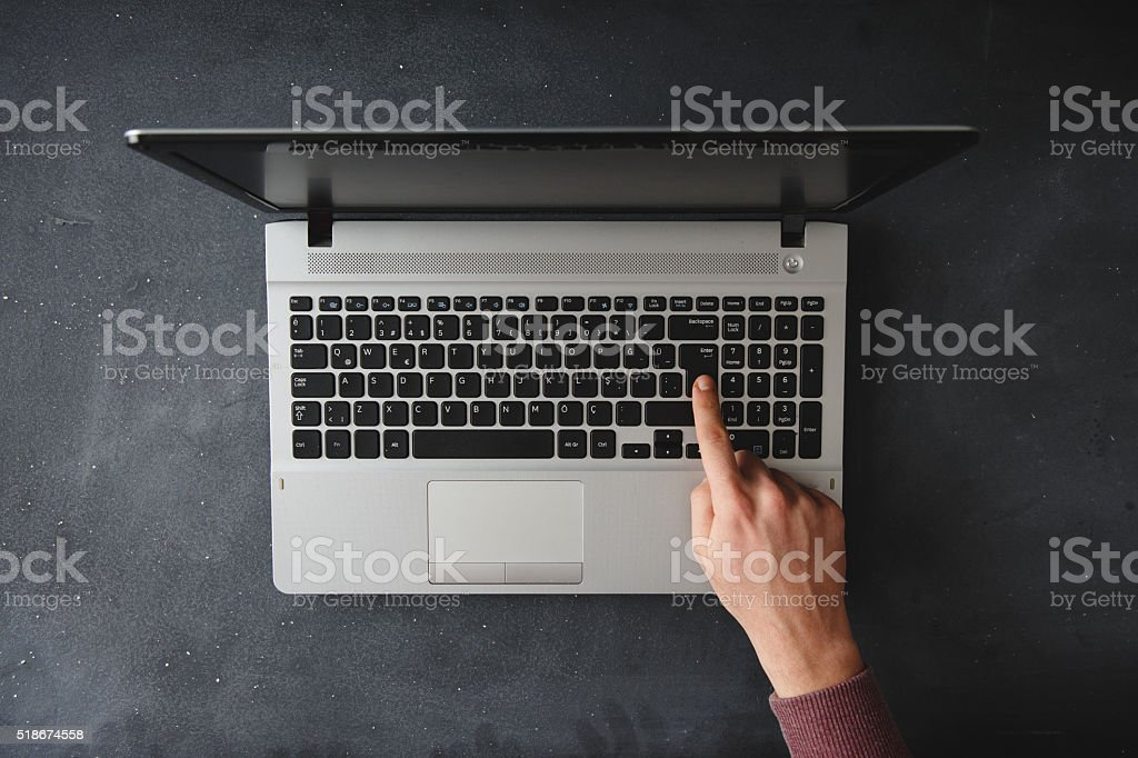 Young man hands on laptop keyboard stock photo