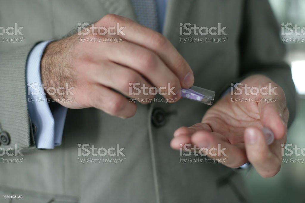 Young man hands with pinky eyebrow tweezer stock photo
