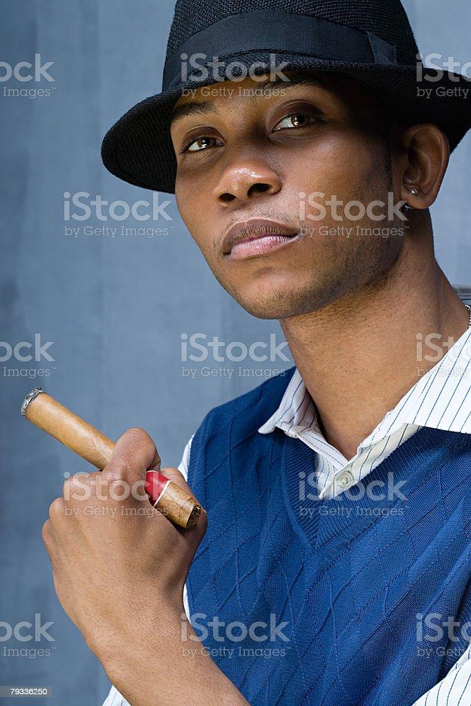 Young man having a cigar royalty-free stock photo