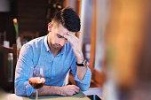 Young man having a headache on a meeting
