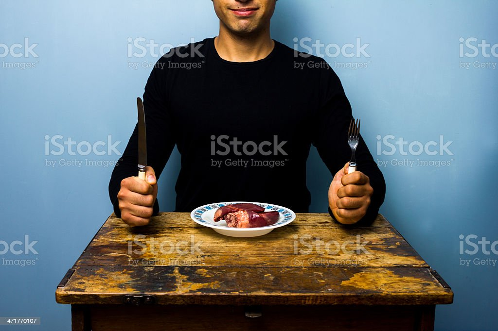 Young man having a heart for lunch royalty-free stock photo