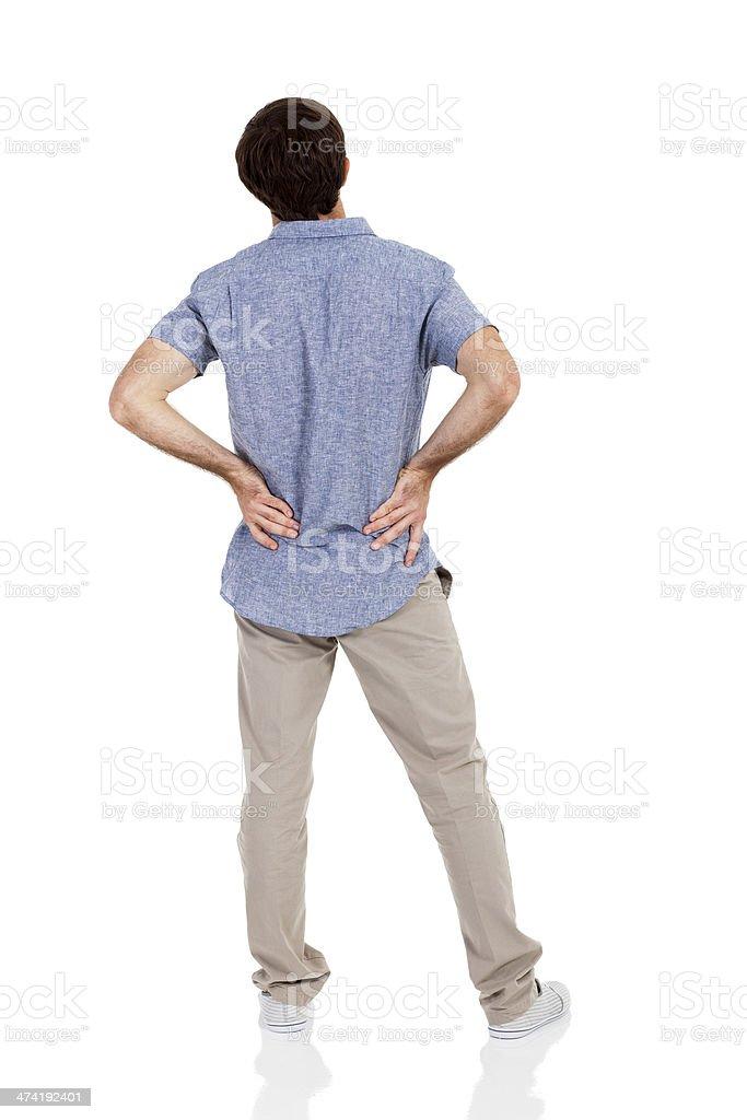 young man having back pain stock photo