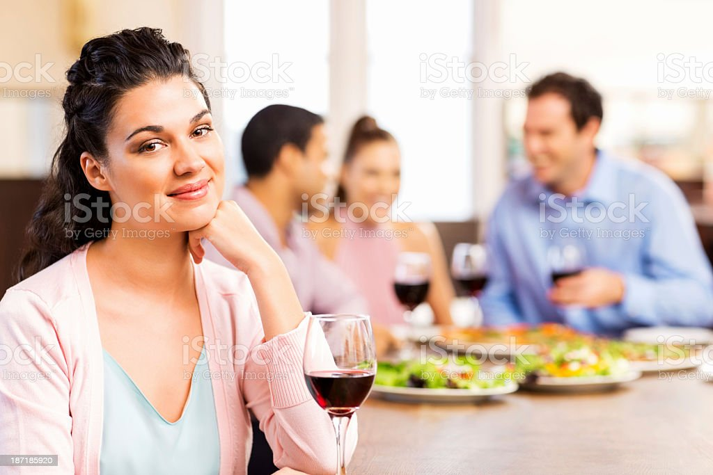 Young Man Having Dinner With Friends In Restaurant royalty-free stock photo