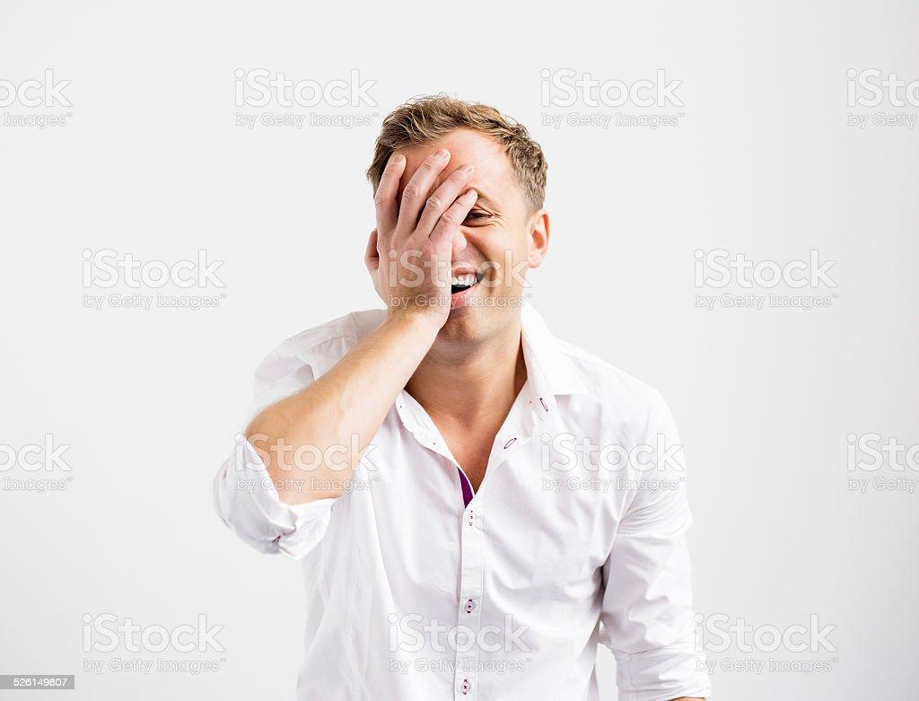 Young man having duh moment stock photo