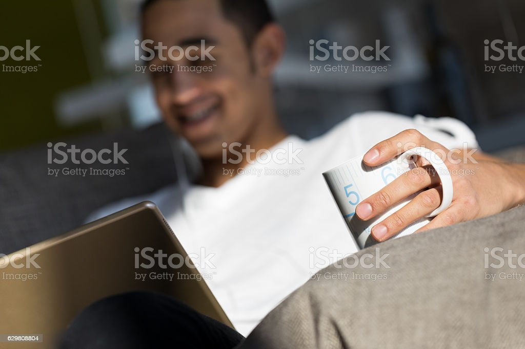young man having fun with movies and drink stock photo